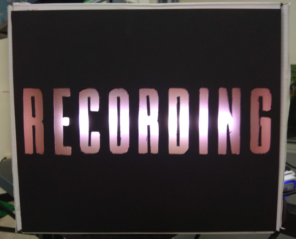 A lighted recording sign