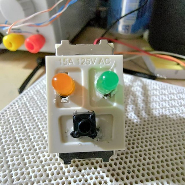 electrical outlet converted into an LED and button holder